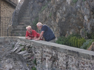 two men discussion rock walkway