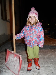 girl shoveling snow